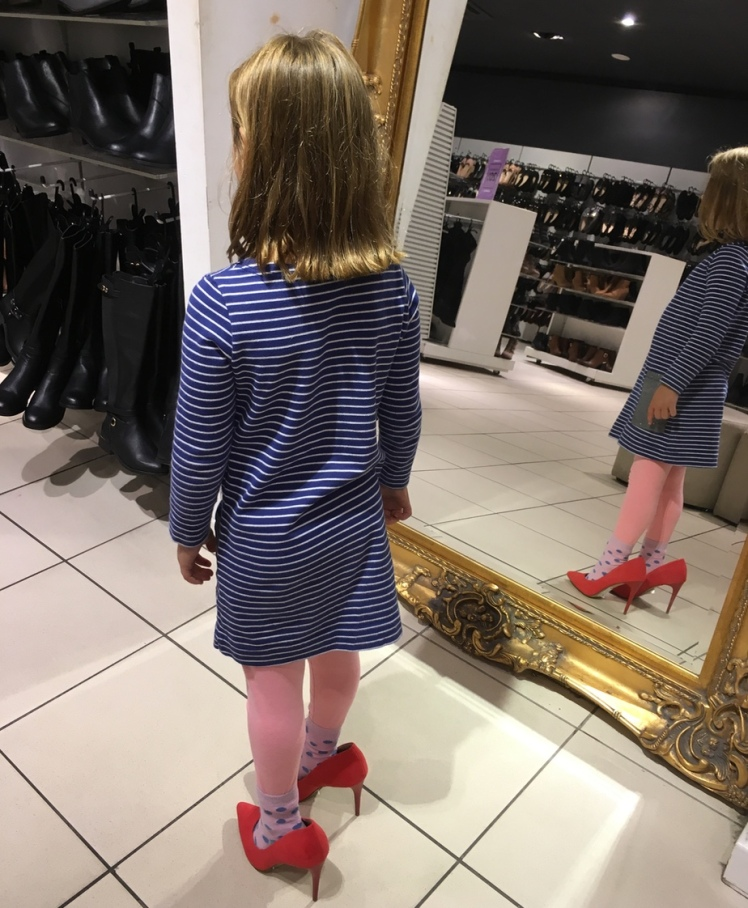 trying on the heels age 5